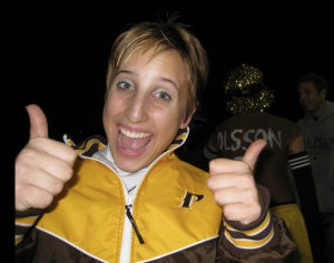 With a pixie haircut, I stood out within our cheerleading squad. Circa 2008.